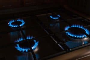 Four-burning-burners-with-blue-flames-on-the-gas-stove