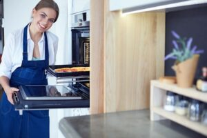 lady-cooking-pizza-in-steam-oven